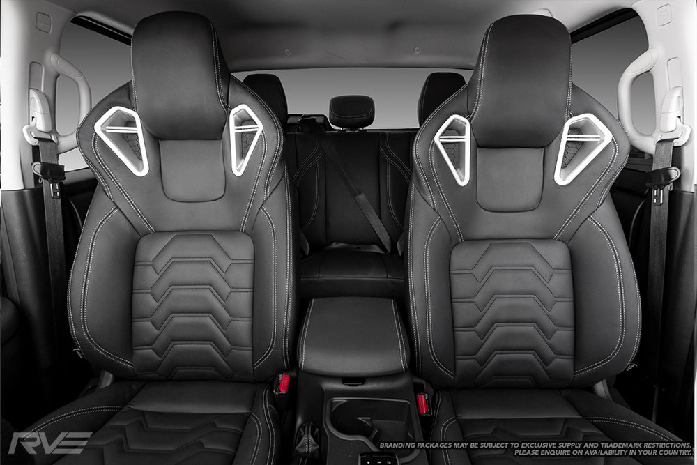 Upgraded race-inspired 'Monza' sport seats in black leather with silver double stitching, 'Armour' inserts and satin silver bolster inserts.  Patent pending #NZ 746521. Design registration #424982, 424983