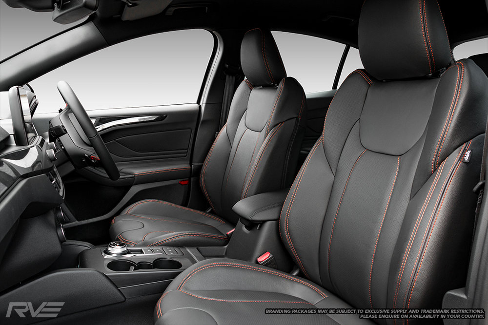 Upgraded gull-wing sport seats in OEM spec black leather with perforated inserts and dark orange double stitching.