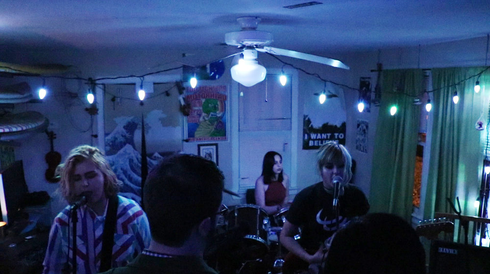 """The band Sour performing during a benefit show to go on their first tour with Dicks From Mars. Both bands received attention in the film as """"representatives"""" of the future of the scene. (My words, not theirs.)"""