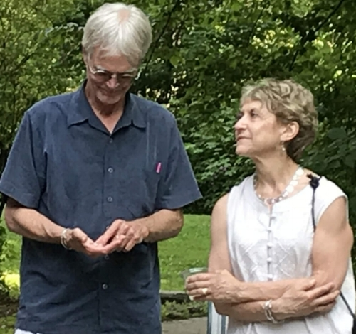David and his wife, Kathy, taking in the surprise of not only extending a medallion to  Dell, but receiving one as well - for his years of service as co-facilitator.