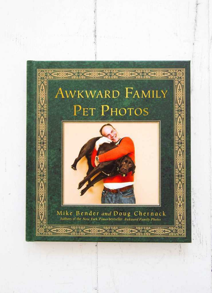 The authors of the New York Times bestseller Awkward Family Photos are back with a hilarious tribute to the unbreakable bond between people and their pets.