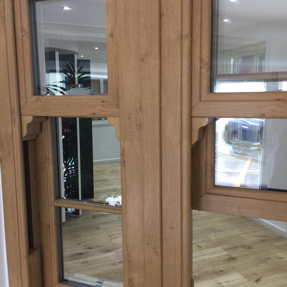 Authentic light oak woodgrain finish shown on this 'flagged' - multiple windows set within single frame - unit.