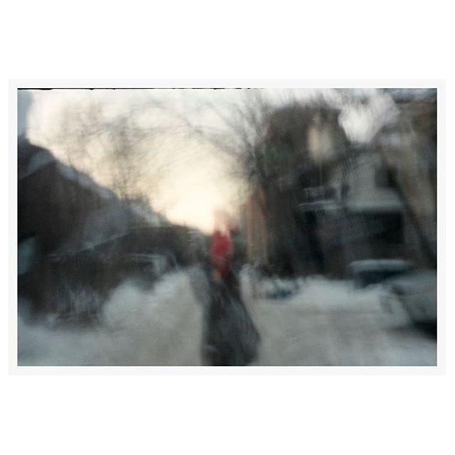 Karine in a snowy alleyway with red thread. Both 35mm, one pinhole. @letempsestunbateau