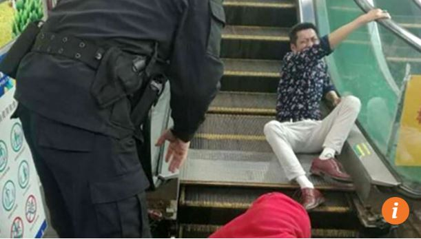 Hmmm.....man gets buttocks stuck in escalator.  Just another day in China.