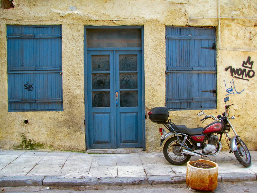blue shutters and motorcycle.jpg