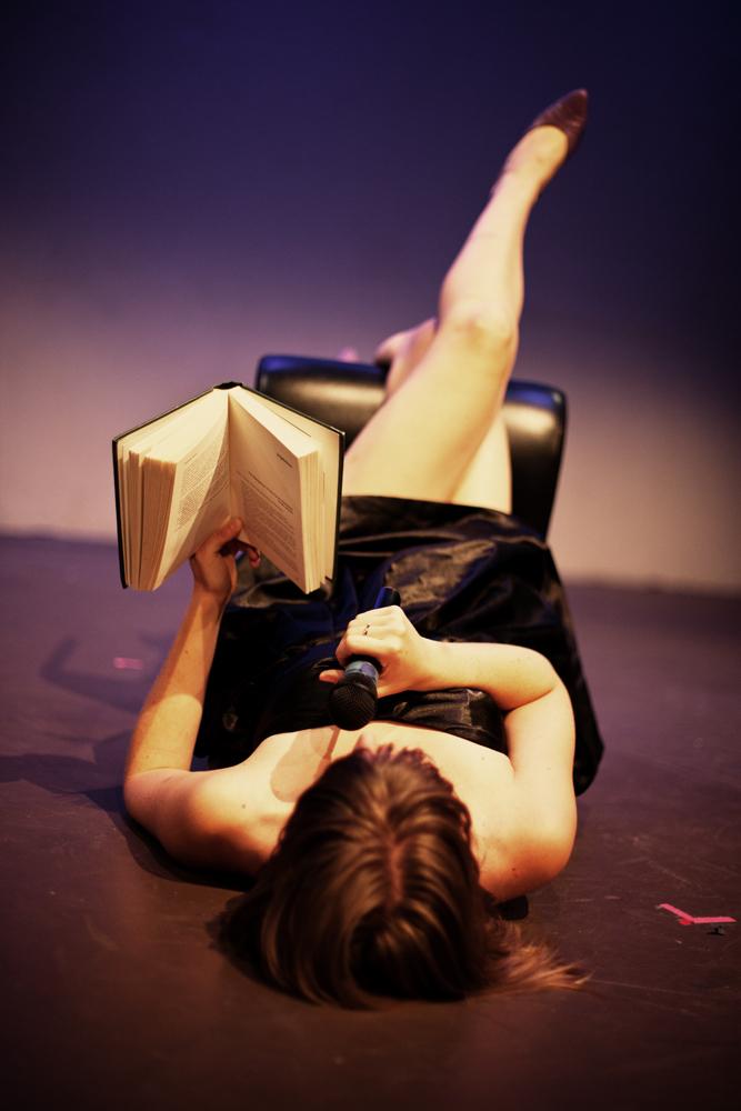 reading in chair on floor.jpg
