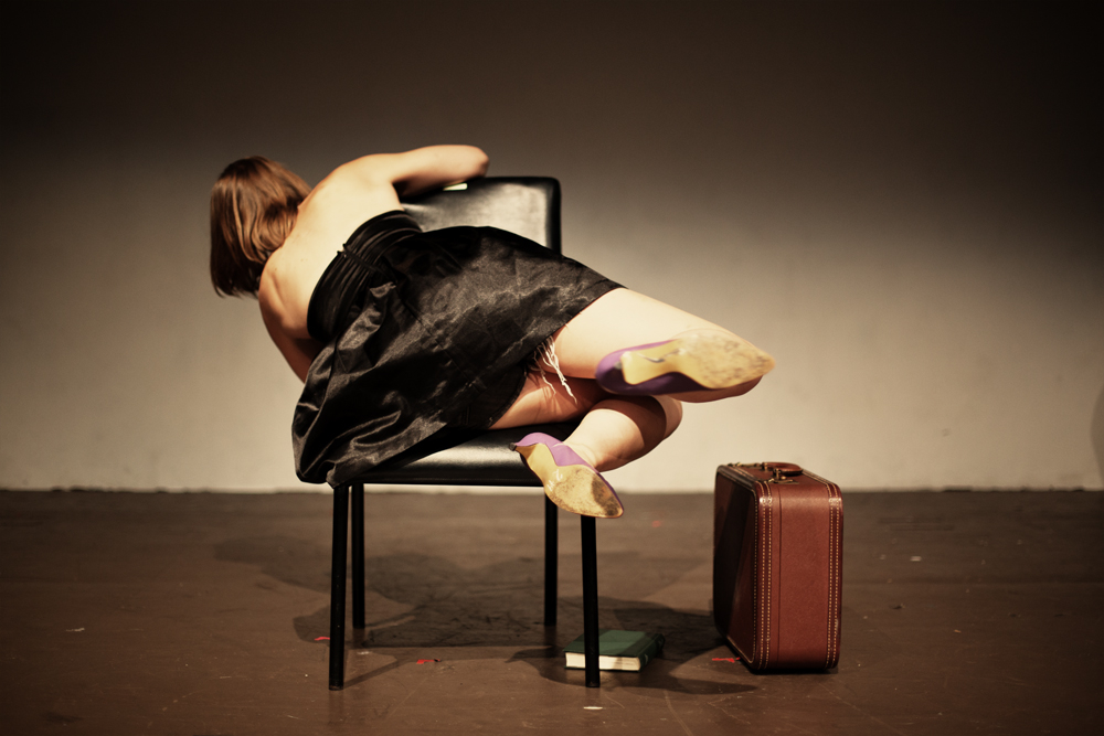 ass in chair dance with suitcase.jpg