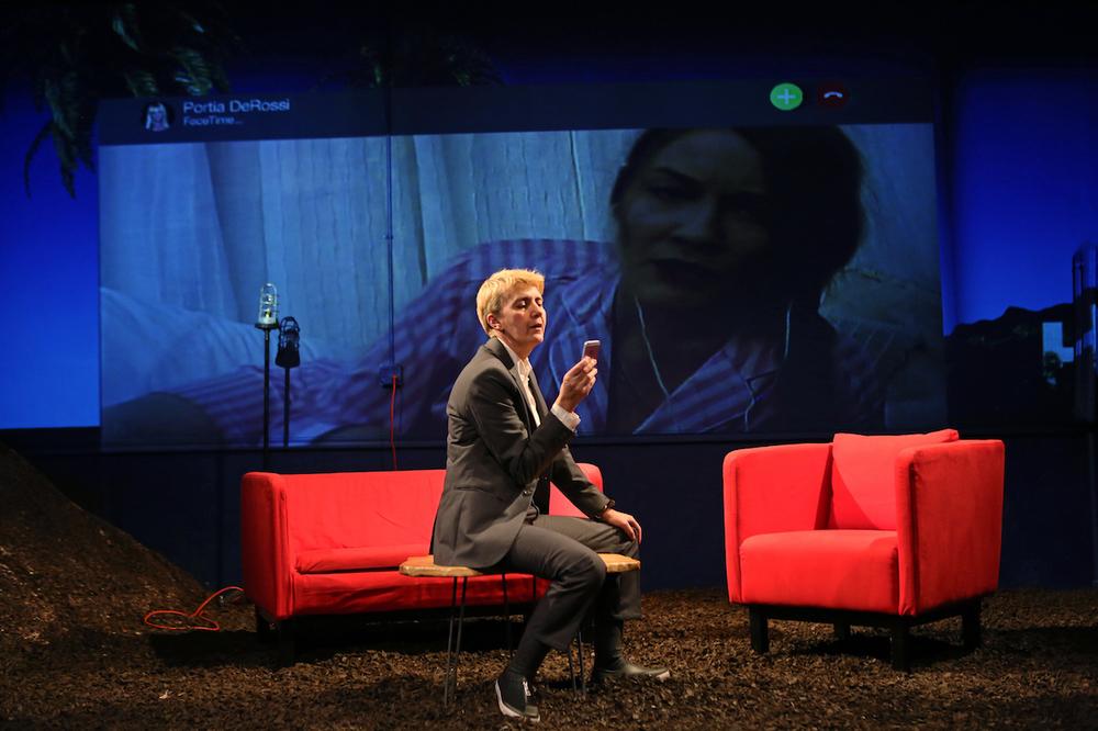 Moe Angelos and Emily Davis (onscreen) as Ellen DeGeneres and Portia de Rossi.