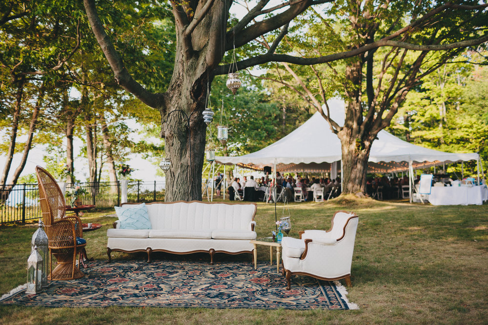seating area With vintage furniture pieces. Bistro Tables covered with borrowed Tapestries.  Vegan blue shoes from Roni Kantor . Photo Credit:  Nickel City Stud ios