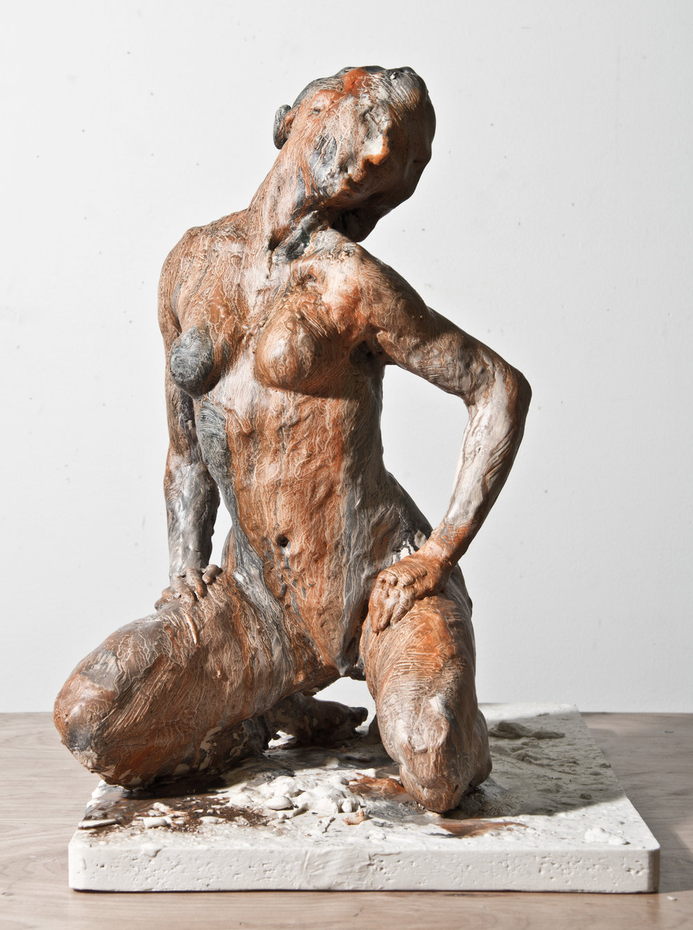 Kneeling Woman, 2012. Bronze 16 x 11 1/2 x 16 in.