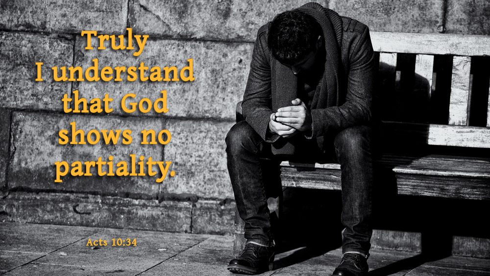 Truly I understand the God shows no partiality. Acts 10:34. This photo shows a man sitting on bench alone.