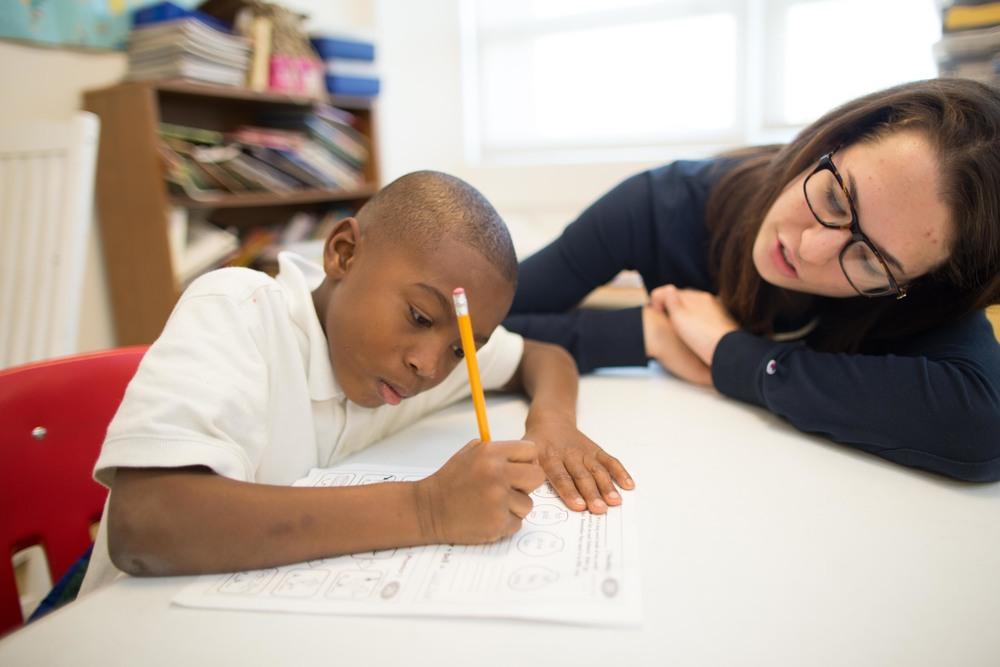 Alainna mentoring at U.S. Dream Academy