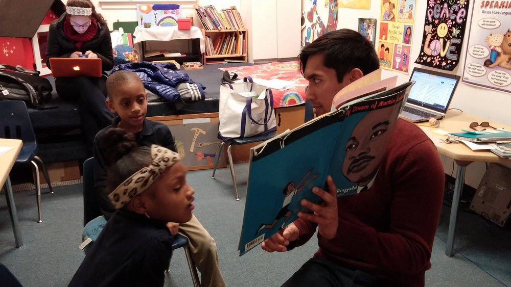 Ethan reads to kids at Little Friends For Peace