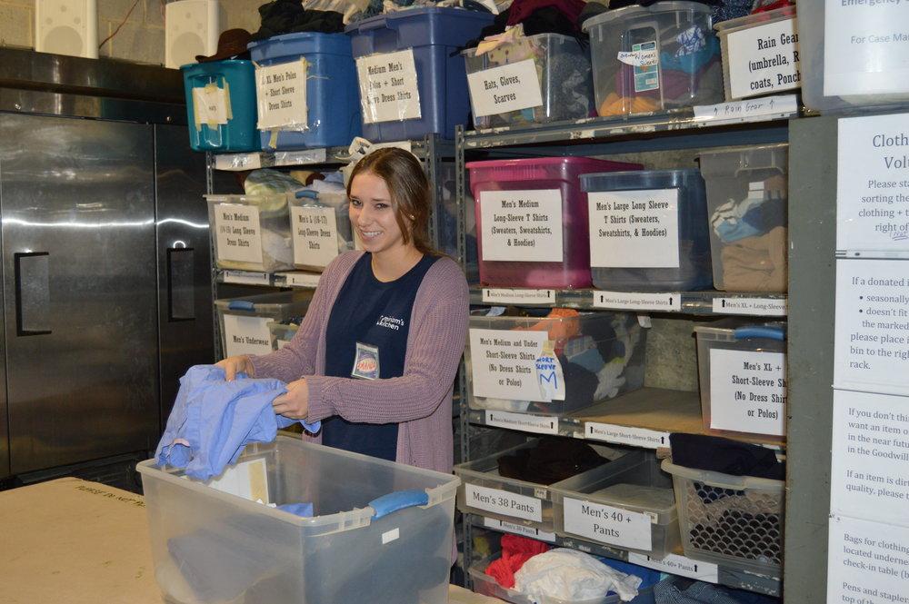 Amanda sorting donations at Miriam's Kitchen