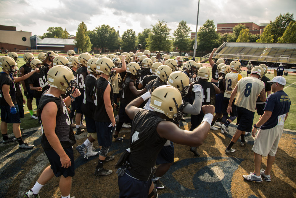 The Gallaudet University Bison football team gets pumped up before practice to the beat of their oversized bass drum. The Bison are the only college-level Deaf team in the world, and are seen as underdogs due to their specific recruiting requirements. Coaches and players for the team will all say the only thing that separates them from their hearing counterparts is their inability to hear the whistle. Everything else, they say, is comparable. (Photo by mimi d'autremont)