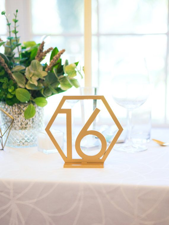 4755139ef96c27f00be4505baff9e4f4--table-numbers-for-wedding-wedding-table-centerpieces.jpg
