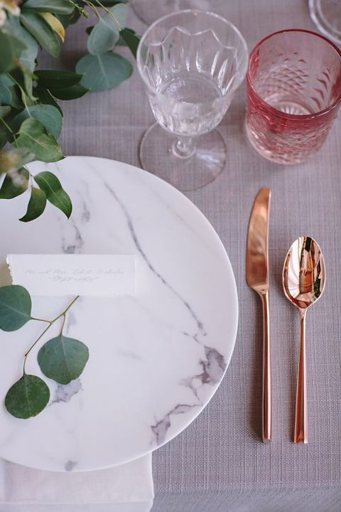 marble-plates-copper-tableware-and-greenery.jpg
