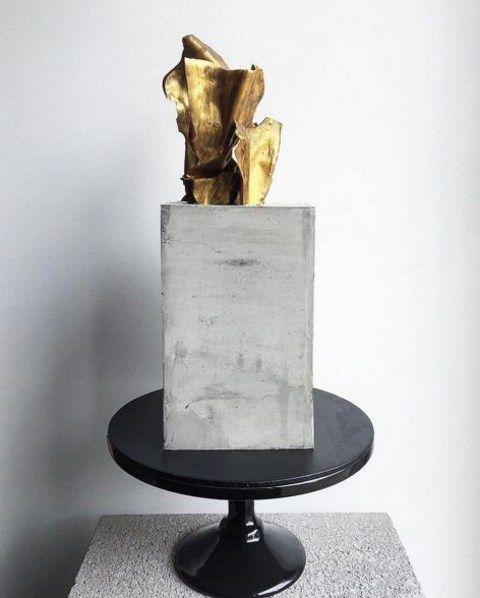 concrete-inspired-wedding-cake-with-gold-decor.jpg