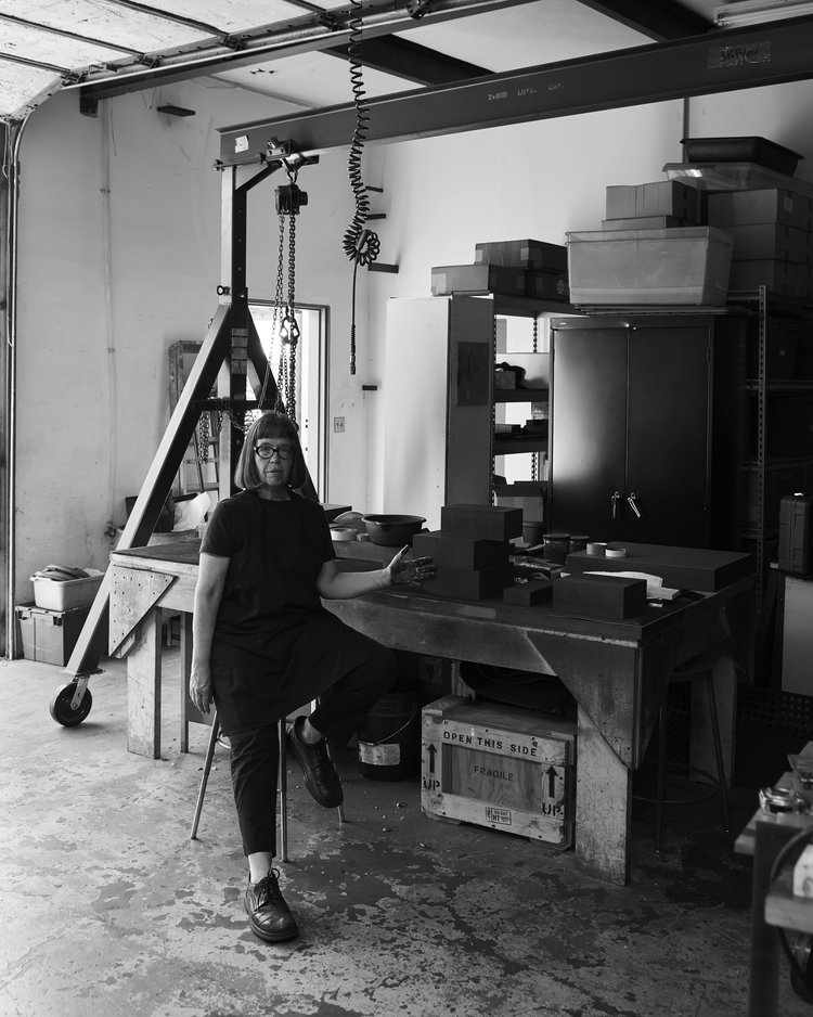 Black and white photograph of Susan York in her studio in Santa Fe.