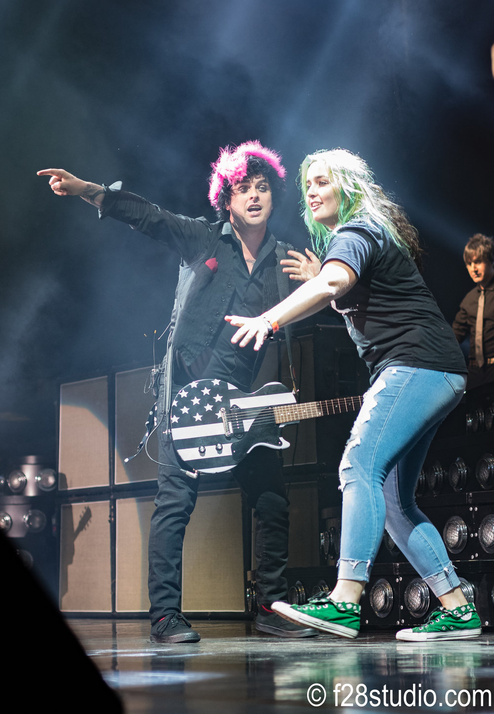 Billie Joe called a fan up to the stage.  She then ran off and stage dived.  They caught her. :)