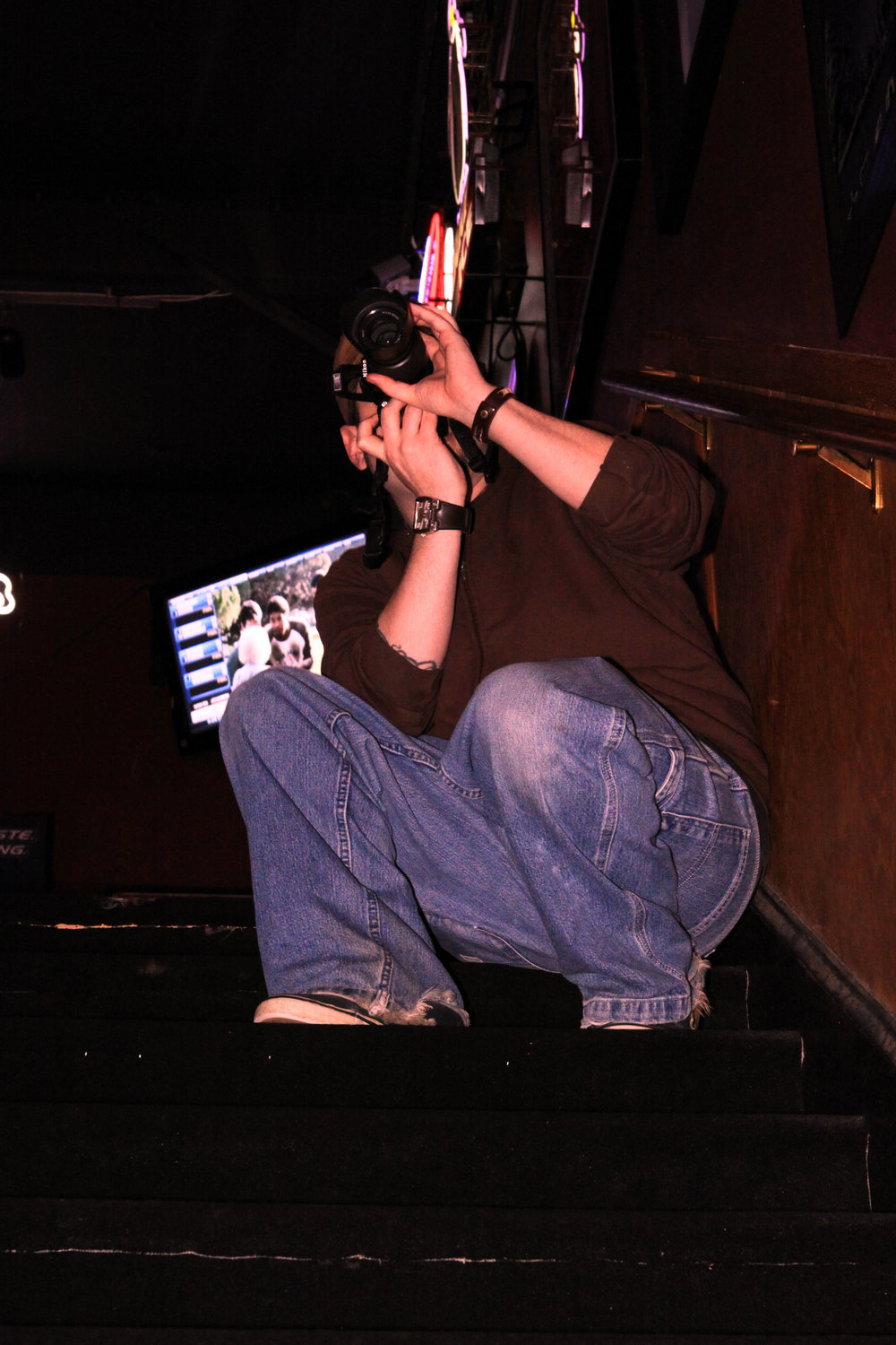 2010 - Picture of me photographing Mostley Crue at a bar in Cary NC. I can't believe I found this!  I also photographed the all Female AC/DC tribute band.  I think it was a different band though.