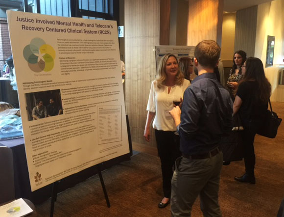 Cheryl Malinowski, Regional Director Central Coast and CORE LA, speaks to participants during the poster session at the Forensic Mental Health Association of California Conference on March 16, 2016.