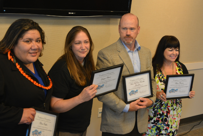 Kevin Jones, second from right, stands among three other honorees at an Oct. 22 award ceremony recognizing excellence in housing. Also pictured is Ohevet Fotofini, a board and care operator; Georgia Peterson, a shelter operator; and Karen Francone of the Service League of San Mateo.