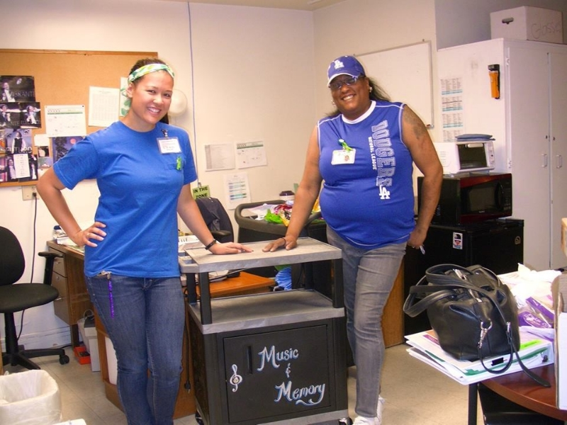 At     La Paz Geropsychiatric Center  ,   staff members,  Erish McInnis  and  Kristen Crowe,  project leads, show off their mobile   Music & Memory cart!
