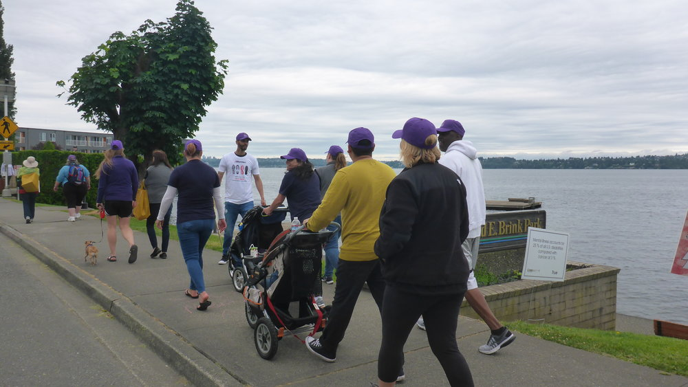 13 Purple hats walking.JPG