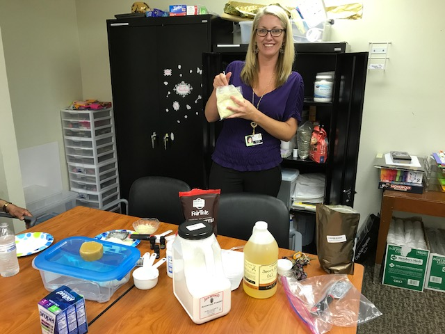Lindy Cain, Team lead at Telecare's Sierra Vista Act, makes bug repellant from household items at her diy group session.