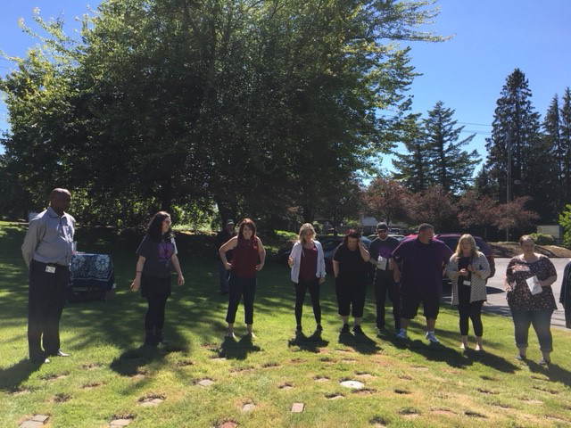 The team at Telecare's Recovery Center at Gresham view their completed labyrinth on the east lawn of their campus.