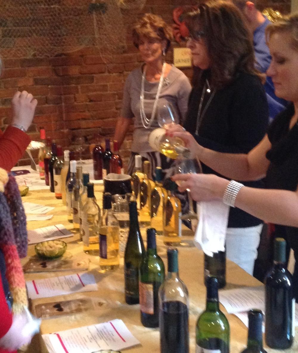 pix-wine tasting 2013 pourers at wine table.JPG