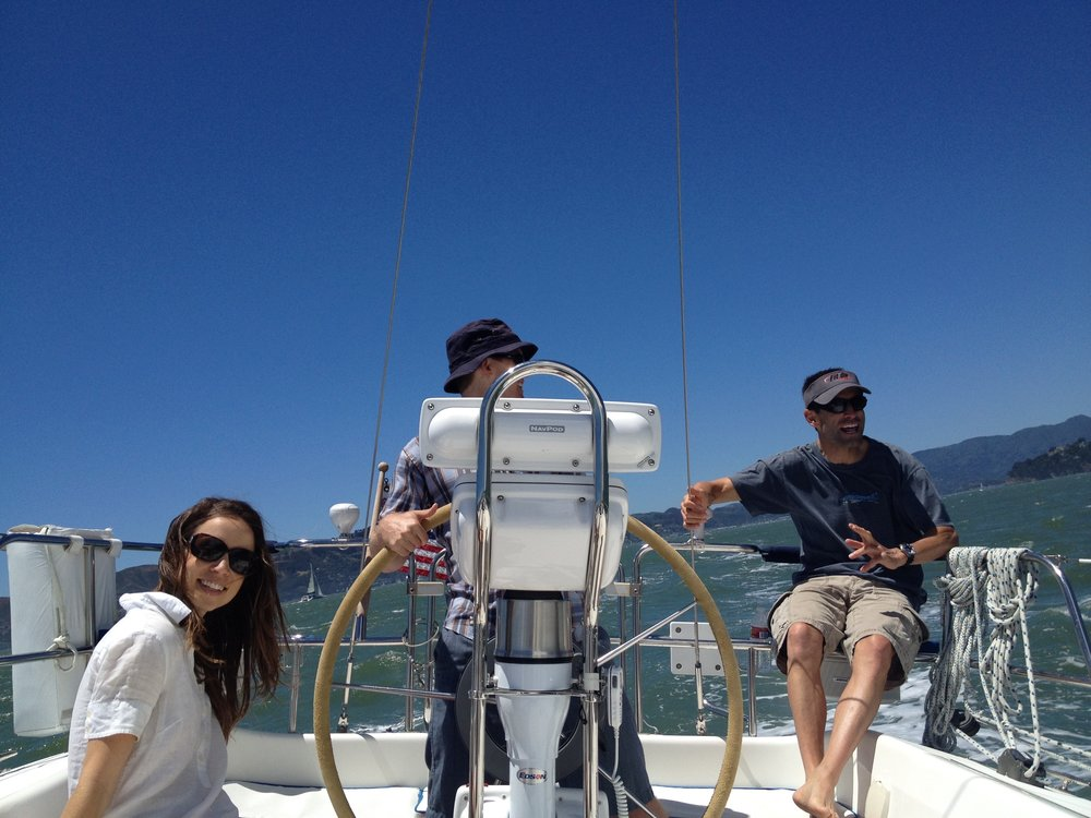Sailing pilot friends on their boat in SF Bay, Ca