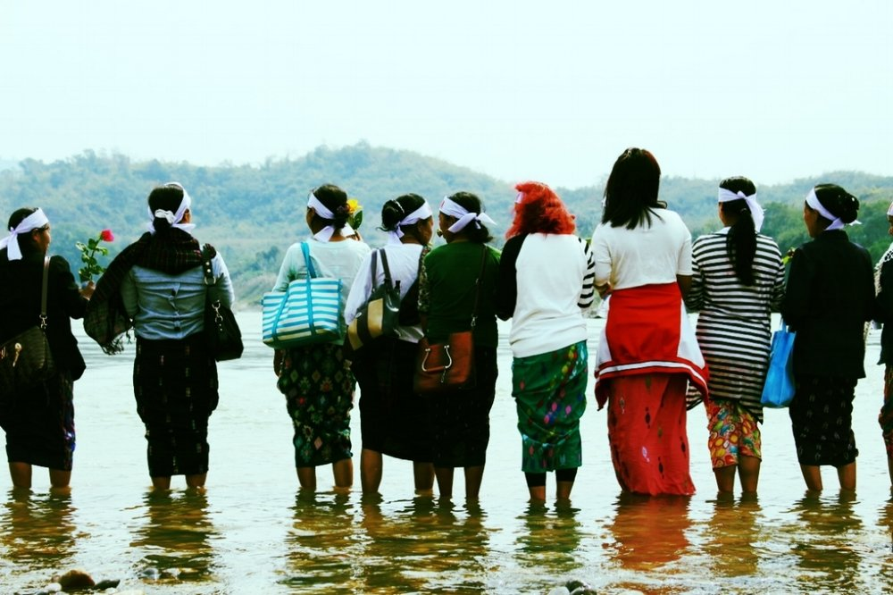 ABOVE AND BELOW THE GROUND - Above and Below the Ground tells the story of daring indigenous women activists and rock musicians who come together in the ongoing struggle against the Myitsone Dam and for environmental self-determination across their native Kachinland. Through investigation, protest, prayer, and music, they test the boundaries of tentative democratic reform in Northern Myanmar, and work to create a future in which native peoples have the right to care for and protect their own lands and natural resources.Click here to read more about this feature-length documentary film.