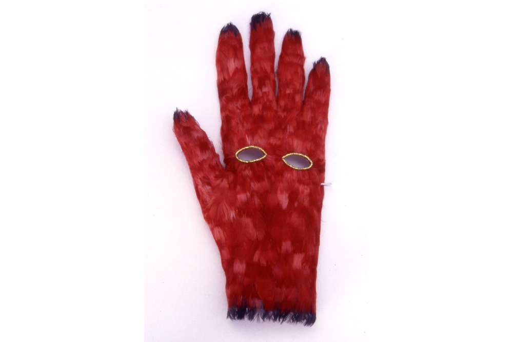 "THE GLOVE IS THE MASK OF THE HAND  A feathered glove with elastic strap that ""masks"" the palm of the hand. Part of an ongoing series  HOW TO SEW A GLOVE,  a collection of hand-made conceptual gloves, each accompanied by an original poem."
