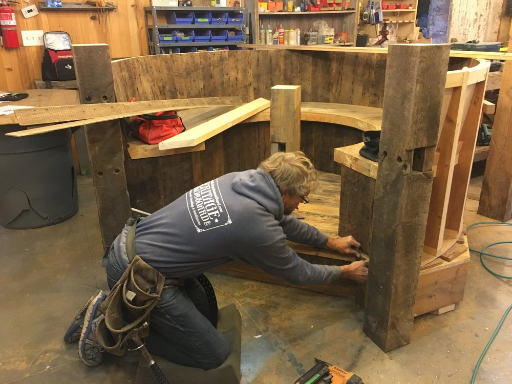 Heritage lead carpenter, Dan, humbling himself before the round booth.
