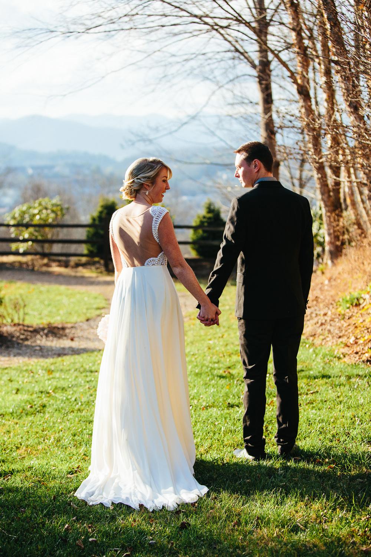 Bride and Groom Asheville Holding Hands.jpg