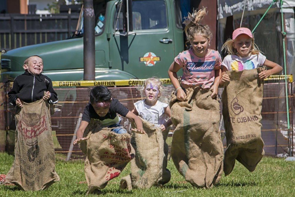 Kids having fun with the old fashioned sack races