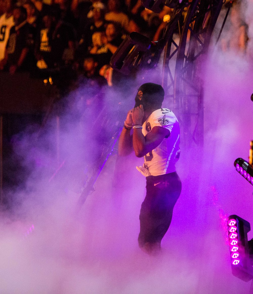 New Orleans Saints wide receiver Michael Thomas (13) puts on a mask as he makes his entrance into the Superdome before an NFL game against the Washington Redskins in New Orleans, La. Monday, Oct. 8, 2018.