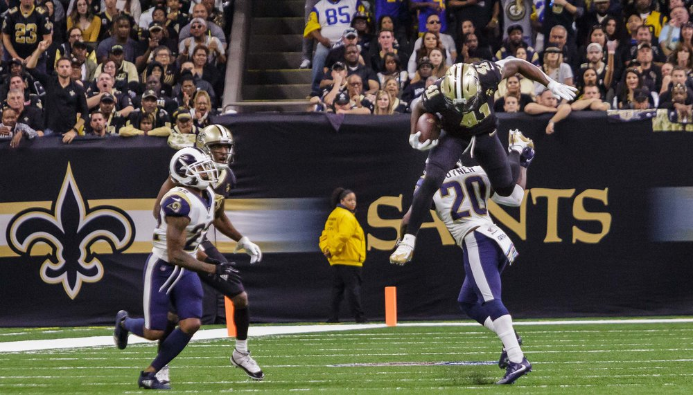 New Orleans Saints running back Alvin Kamara (41) leaps over Los Angeles Rams free safety Lamarcus Joyner (20) during the first second half of an NFL football game against the Los Angeles Rams in New Orleans, La. Sunday, Nov. 4, 2018.