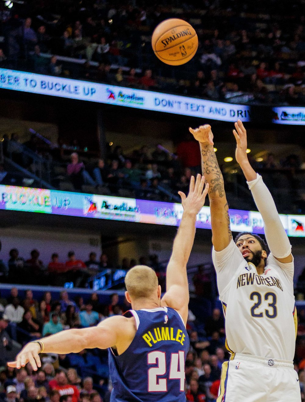 New Orleans Pelicans for­ward Anthony Davis (23) shoots over Denver Nuggets forward Mason Plumlee (24) in the second half of an NBA basketball game in the Smoothie King Center in New Orleans, La. Monday, Nov. 17, 2018. The Pelicans won, 125-115.