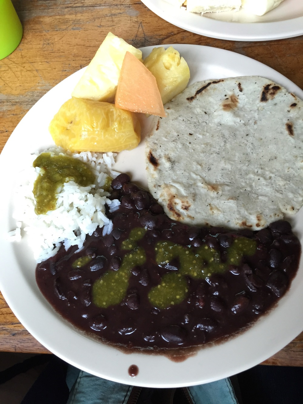 Breakfast -  black beans, tortillas, rice and fruit