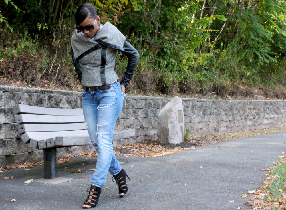 Complete the look with distressed denim and lace-up booties.
