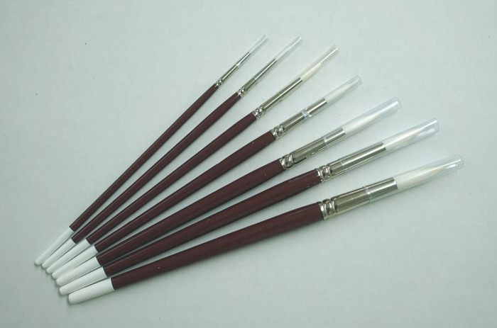 Set of seven red brushes                                                $42.00
