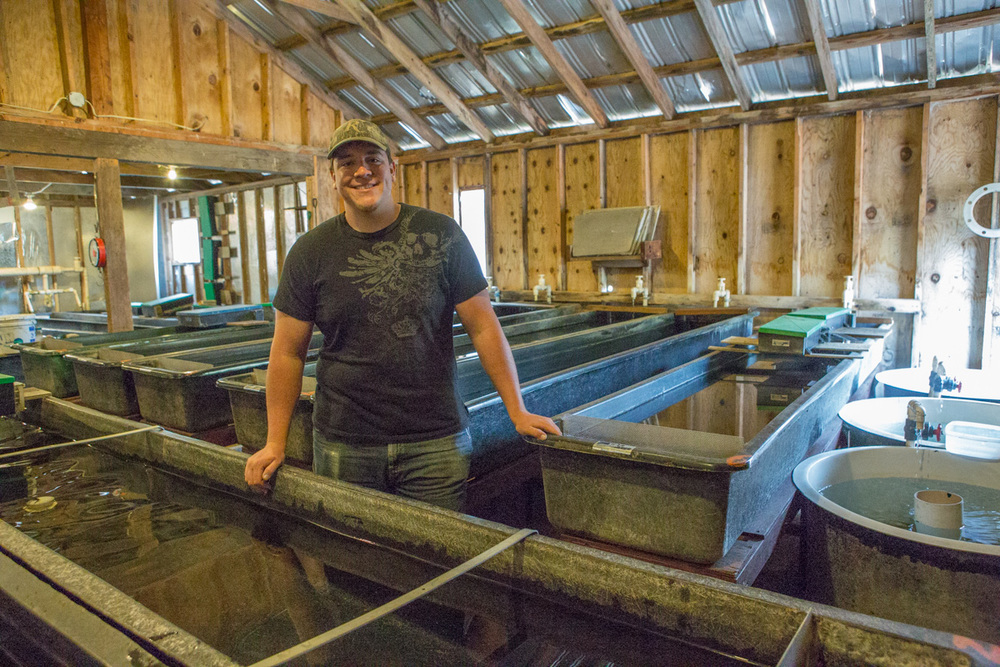 Fish Farmer Christian Morgan at McFarland Springs Fish Hatchery. Photography by Julie Ann Fineman.