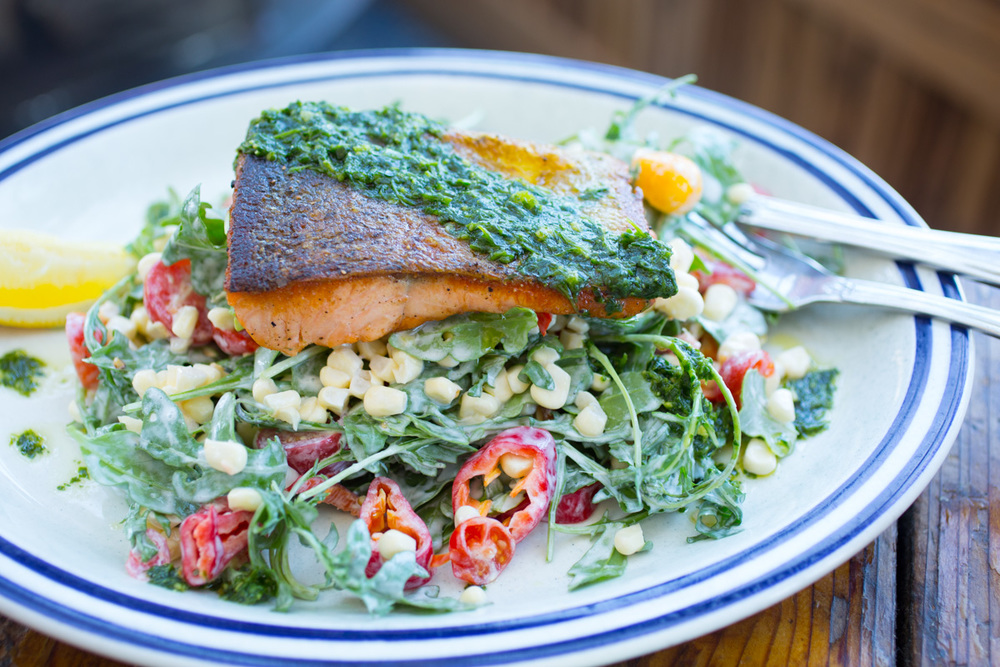 FISH restaurant summertime special: Grilled McFarland Springs Trout over a corn and arugula salad with pickled Jimmy Nardello peppers and basil pesto. Photography by Julie Ann Fineman.
