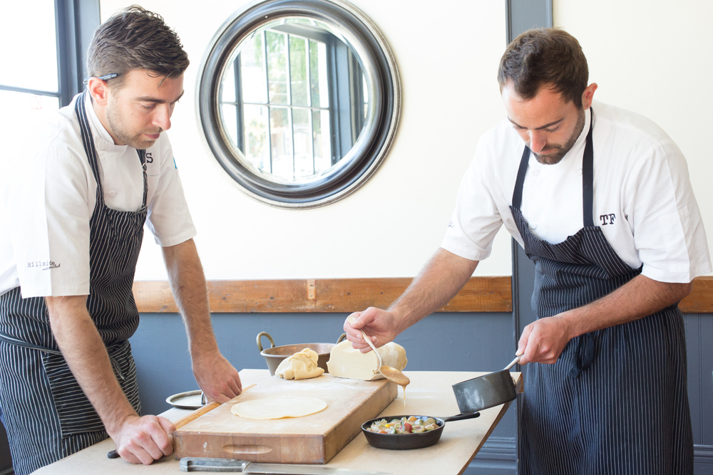 Chefs Jonathan Sutton and Tony Ferrari prepping lamb pies at Hillside Supperclub. Photography ©Julie Ann Fineman.