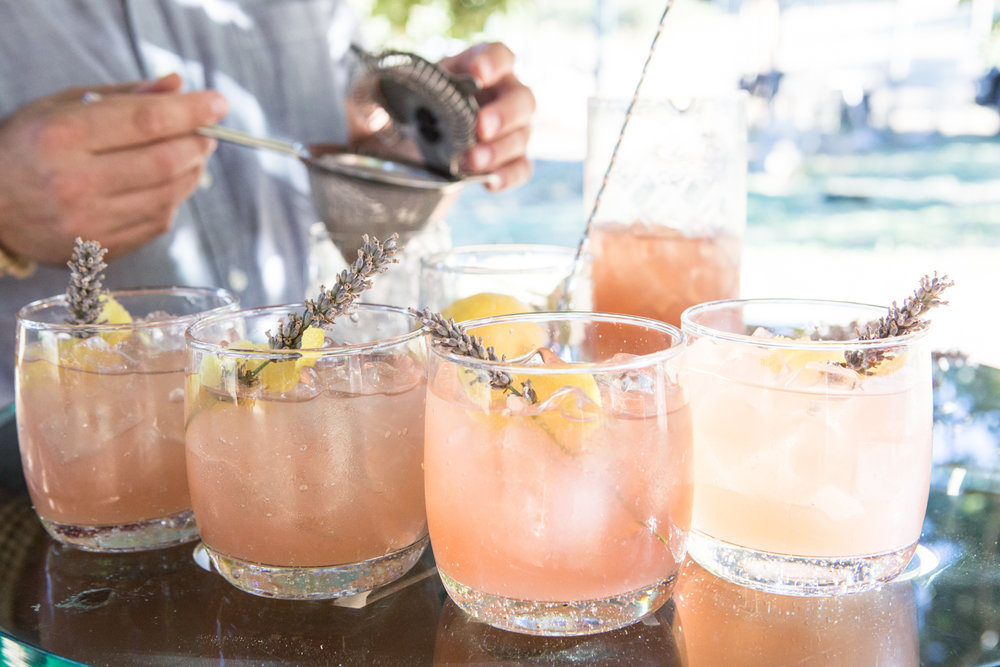 Ca' Momi Chief Hospitality Officer, Jonny Tindall, mixing La Morosa at Ca'Momi Nikadado Farm.  La Morosa [the girlfriend] · Bar Hill Gin · organic Nicadado Farm lavender syrup · fresh organic lemon · Cocchi Barolo Chinotto