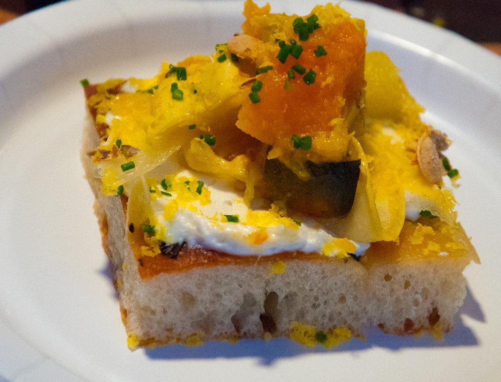 Chef Cody Sharp's squash crostini with Rae Lili Farms winter squash, whipped ricotta and porchetta cured egg yolk