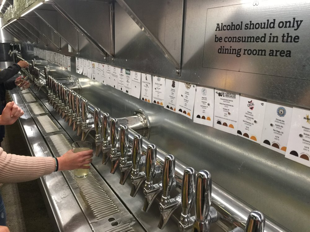 Beverage bar supports an array of local beverage makers: wineries, brewers, juicers, kombucha masters. Self serve reflects Airbnb's commitment to reduce waste from food, drink and packaging